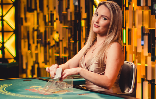 Enjoy the company of a blond dealer girl while playing poker.